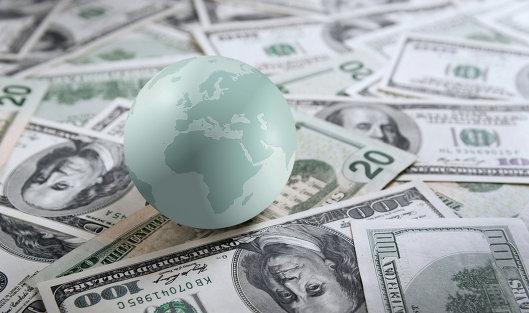 Глобус и банкноты