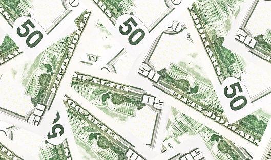 *Долларовые банкноты