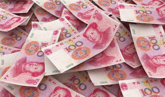 773377912 - Народный банк Китая ослабил курс юаня к доллару на 0,38%