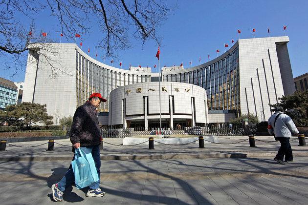 Центральный банк Китая укрепил курс юаня к доллару