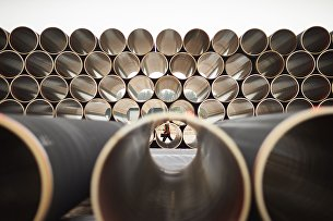 "# Pipes for the gas pipeline ""Nord Stream - 2"" at the factory for concreting in Kotka, Finland"