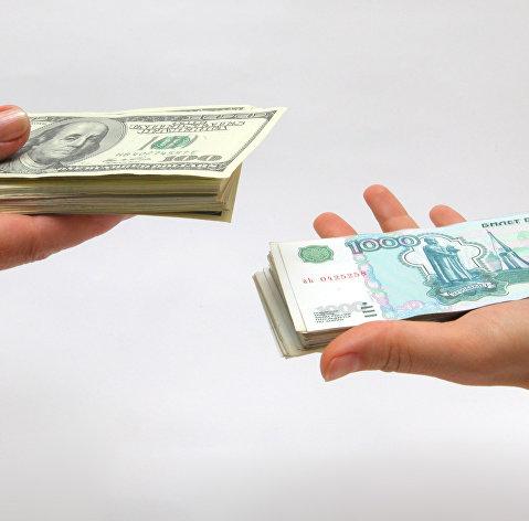 Средневзвешенный курс доллара снизился до 73,43 рубля