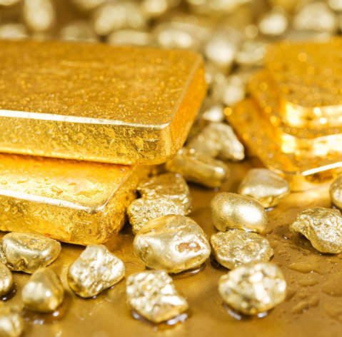 Падение цены на золото ускорилось почти до 2% на укреплении доллара
