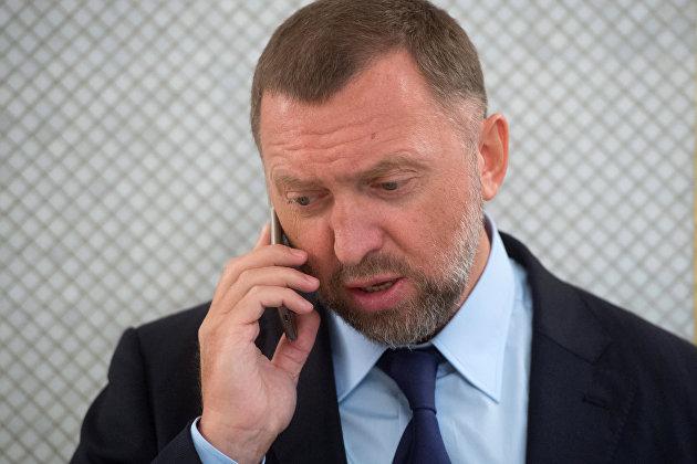 """Мосбиржа возобновит торги акциями """"Русала""""  после его перерегистрации в России"""