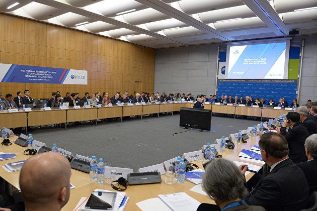 """Страны ОЭСР договорились о введении """"глобального налога"""" в 15% на международные компании"""